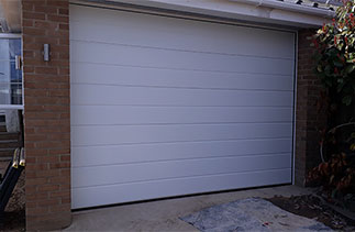 A Carteck Centre rib style white insulated sectional garage door. Fitted in Crowthorne, Berkshire.