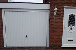 A Garador Carlton style steel up and over garage door door with a steel frame. Fitted in Ash, Hampshire.