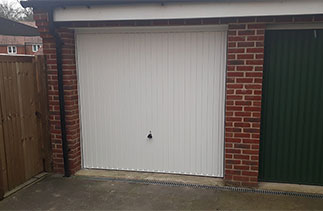 A Garador Carlton style steel up and over garage door with a steel frame. Fitted in Bagshot, Surrey.