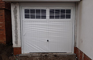 A Garador Salisbury style up and over steel garage door with a steel frame. One of Three fitted in Horsham, West Sussex.