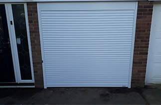A Gliderol 55mm Compact insulated roller shutter garage door. Fitted in Camberley, Surrey.