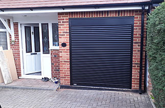 A Gliderol 55mm Compact insulated roller shutter garage door. Fitted in Laleham, Surrey.