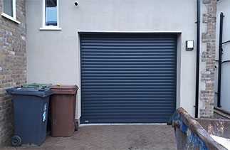 A Sws Seceuroglide Excel insulated roller shutter garage door. Fitted in Camberley, Surrey.