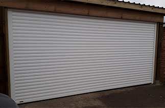 A Sws Seceuroglide Excel insulated roller shutter garage door. Fitted in Surrey.