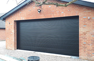 A Sws Seceuroglide Excel insulated roller shutter garage door. Fitted in Wargrave, Berkshire.