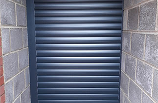 A Sws Seceuroglide Excel insulated roller shutter garage door. Fitted in Woodley, Berkshire.