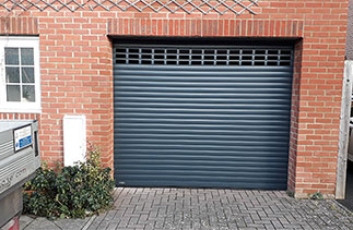 A Sws Seceuroglide Excel insulated roller shutter garage door, with vented windows. Fitted near Basingstoke, Hampshire.