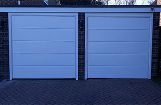 Two Garador Ascot style steel up and over garage doors with steel frames. Fitted in Camberley, Surrey.