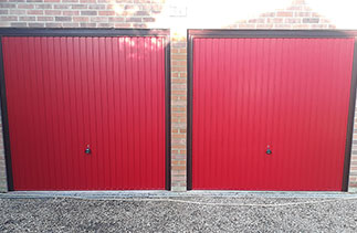 Two Garador Carlton style up and over garage doors in Red, With Burgundy steel frame and Rosewood PVC. Fitted in Woodley, Berkshire.