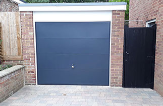 A Garador steel range up and over garage door from the design range. In the style 100, in Anthracite Grey with a White steel frame. Fitted in Camberley. Surrey.