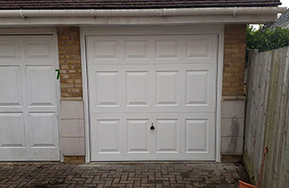 A Garador steel range up and over garage door. In the Beaumont style in White with a White steel frame. Fitted in Deepcut, Surrey.
