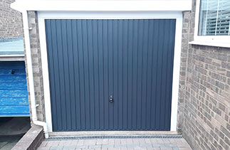 A Garador steel range up and over garage door in the Carlton style. In Anthracite Grey with a White steel frame. Fitted in Bordon. Hampshire.