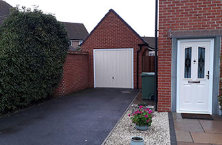 A Garador steel range up and over garage door in the Carlton style. In Light Ivory, with a white steel frame. Fitted in Basingstoke. Hampshire.