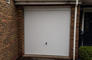 A Garador steel range up and over garage door in the Carlton style. In White with a White steel frame. Fitted in Sandhurst. Berkshire.