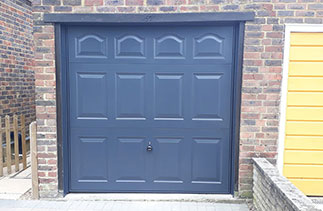 A Garador steel range up and over garage door in the Cathedral style. In Anthracite Grey with a Anthracite Grey steel frame. Fitted near Aldershot. Hampshire.