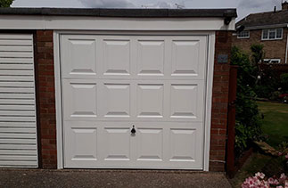 A Garador steel range up and over garage door in the Georgian style. In White with a White steel frame. Fitted in Farnborough. Hampshire.