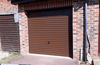 A Garador steel range up and over garage door in the Horizon style. In Brown with a Brown  steel frame. Fitted in Farnborough. Hampshire.