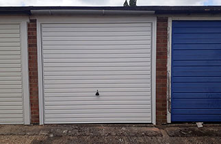 A Garador steel range up and over garage door in the Horizon style. In White with a White steel frame. Fitted in Aldershot. Hampshire.