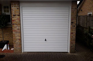 A Garador steel range up and over garage door in the Horizon style. In White with a White steel frame. Fitted in Camberley. Surrey.