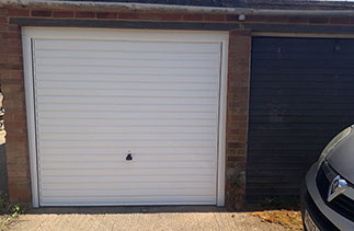A Garador steel range up and over garage door in the Horizon style. In White with a White steel frame. Fitted in Farnborough. Hampshire.