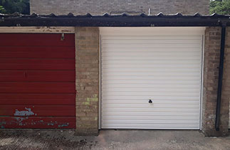 A Garador steel range up and over garage door in the Horizon style. With a White steel frame. Fitted in Fleet. Hampshire.