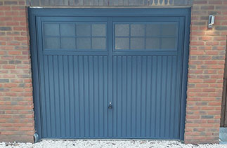 A Garador steel range up and over garage door. In the Salisbury style. In Slate Grey with a matching steel frame. Fitted in Herriard. Near Basingstoke. Hampshire.