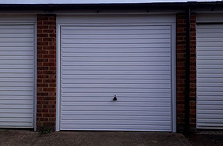 A Garador steel range up and over garage. In the Horizon style in White. With a White. Fitted in a block of Garages. Fitted in Woking. Surrey