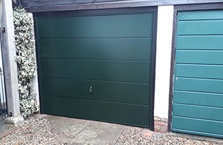 A Garador steel up and over garage door in the Ascot Style in Fir Green with Black Ash Pvc trims. Fitted in Henley On Thames. Oxfordshire.