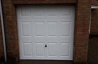 A Garador steel up and over garage door in the Georgian style in White. With a white steel frame. Fitted in Bracknell. Berkshire.