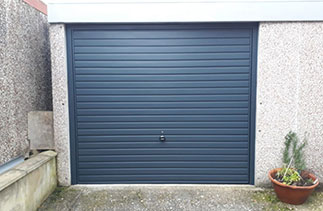 A Garador steel up and over garage door in the Horizon style in Anthracite Grey. Fitted in Farnborough, Hampshire.