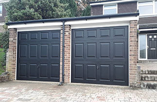 Two Garador steel range up and over garage doors. In the Beaumont style, in Black With White steel frames. Fitted in Ascot. Berkshire.