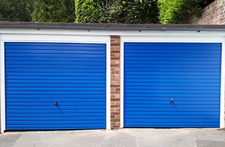 Two Garador steel range up and over garage doors in the Horizon style. In signal Blue with White steel frames. Fitted in Woking. Surrey.