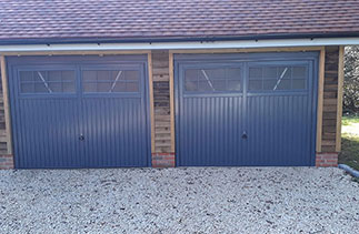 Two Garador steel range up and over garage doors. In the Salisbury style, in Slate Grey. With matching steel frames and with Four point locking. Fitted in Herriard. Near Basingstoke. Hampshire.