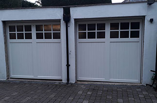 Two Woodrite timber up and over garage doors. From the Buckingham range, in the Birton style. Finished in White Ral. With matching hard wood frames. Fitted in Yatley. Hampshire.