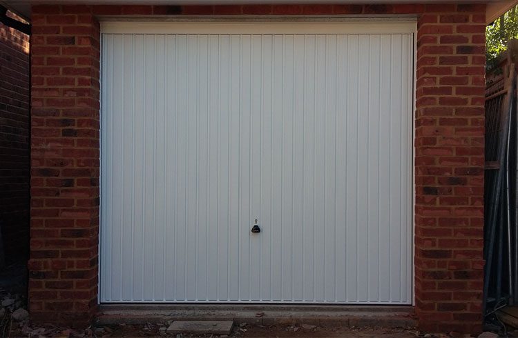 A Garador Carlton framed retractable plus door with steel frame. Fitting behind the opening