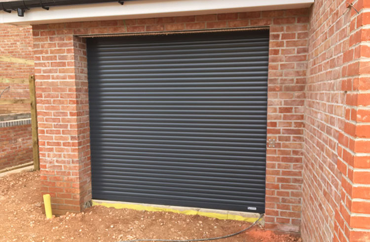 A Gliderol compact insulated electronically operated roller shutter garage door in Anthracite Fitted in Four Marks