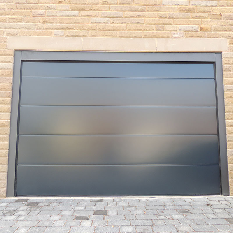 Insulated steel panel sectional garage doors right for Oversized garage door