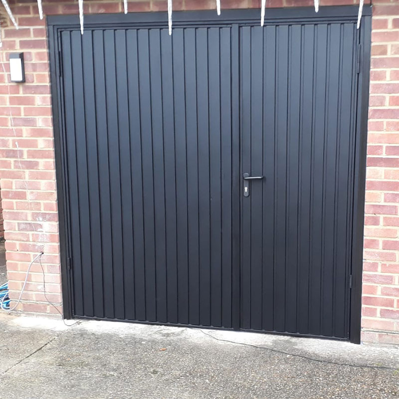 Side hinged garage doors installation gallery