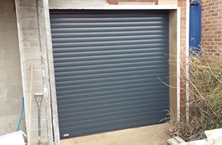 A Anthracite Seceuroglide Excel insulated roller shutter garage door fitted in Ottershaw, Surrey.