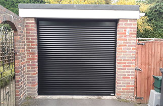 A Black Gliderol 55mm Compact insulated Roller Shutter Garage Door fitted in Camberley, Surrey.