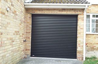A Black insulated roller shutter garage door fitted in Camberley, Surrey