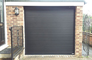 A Gliderol 55 compact Black roller shutter garage door fitted with matching guides and a matching full box. Fitted in Mytchett, Surrey.