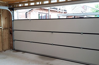Further assembling of a Carteck sectional garage door. Fitted in Wokingham, Berkshire.