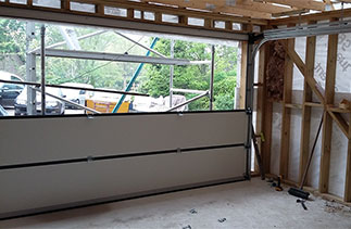 The assembling of a Carteck Sectional garage door. Fitted in Wokingham, Berkshire.