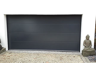 A Carteck Solid rib style garage door in Anthracite fitted in Camberley, Surrey.