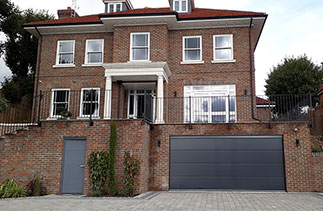 A Carteck Solid rib sectional garage door in Anthracite Grey. Fitted in Guildford, Surrey.