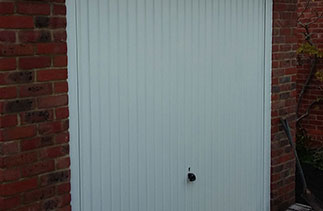 A Garador Carlton framed retractable plus garage door, complete with a steel frame and electronic operator