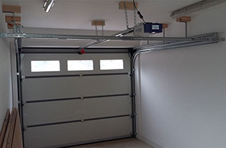 Inside view of a sectional garage door fitted with a belt driven electronic operator