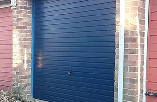 A Garador Horizon canopy garage door finished in steel Blue fitted in Mytchet Surrey