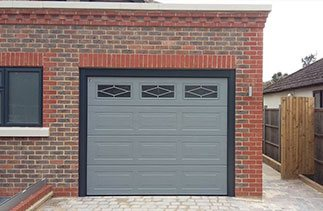 Carteck sectional Garage door in RAL 7037 with a RAL 7016 frame and 3D cover profile kit, with Rhombus widows